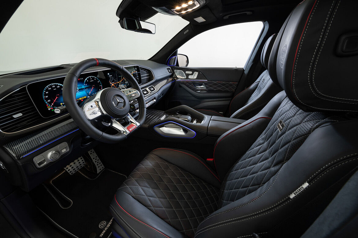 Gets black leather upholstery with grey stitching and red-piping for a contrast look