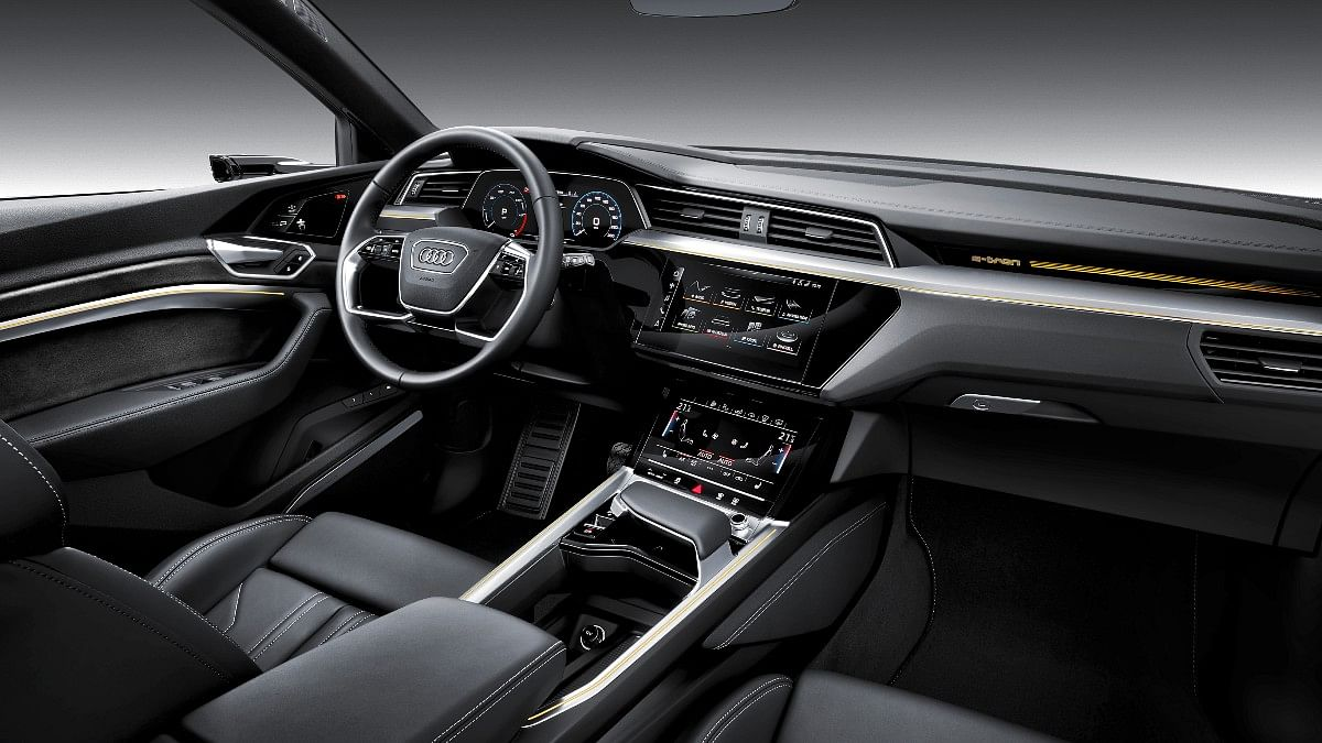 The e-tron twins get Audi's new age interior design with a four-spoke steering wheel