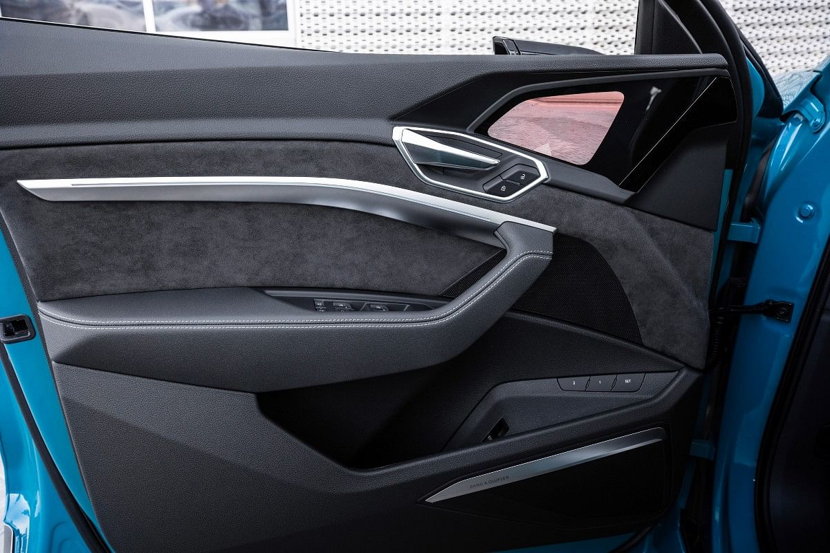 Dark brushed aluminium upholstery on the doors give the e-tron a sporty appeal