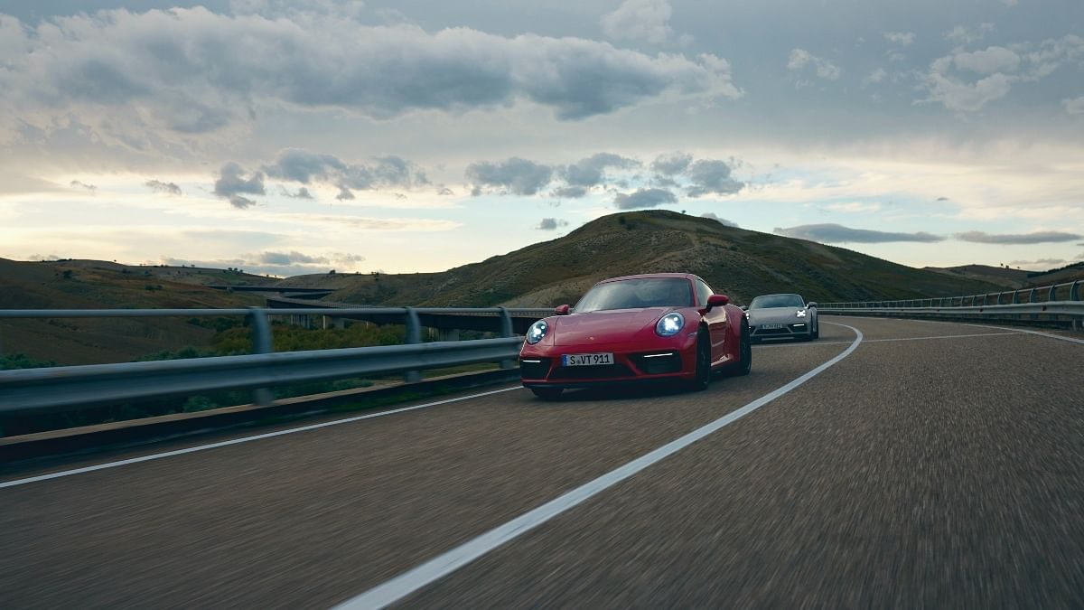 The new 911 GTS is available in coupe and cabriolet (pictured behind) forms