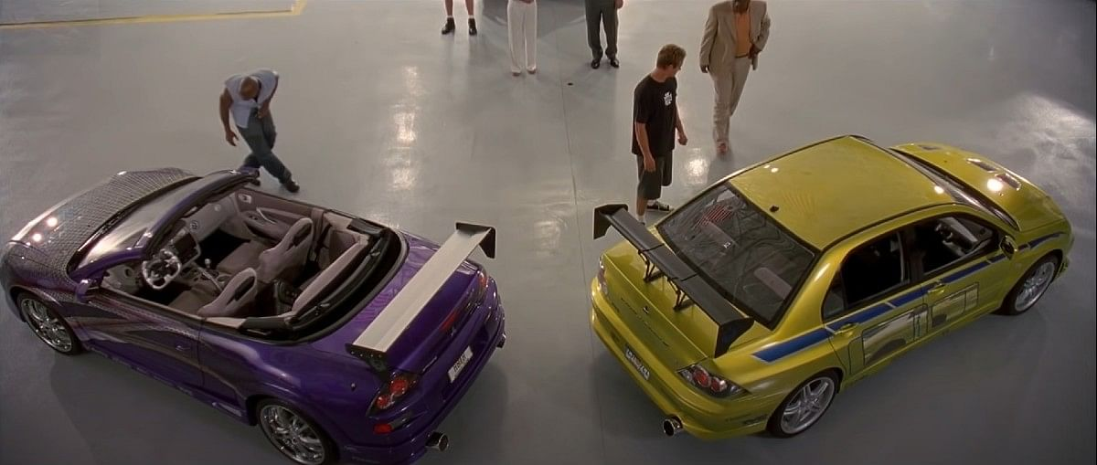 The Mitsubishi Lancer Evo VII when it is revealed in 2 Fast 2 Furious (right)