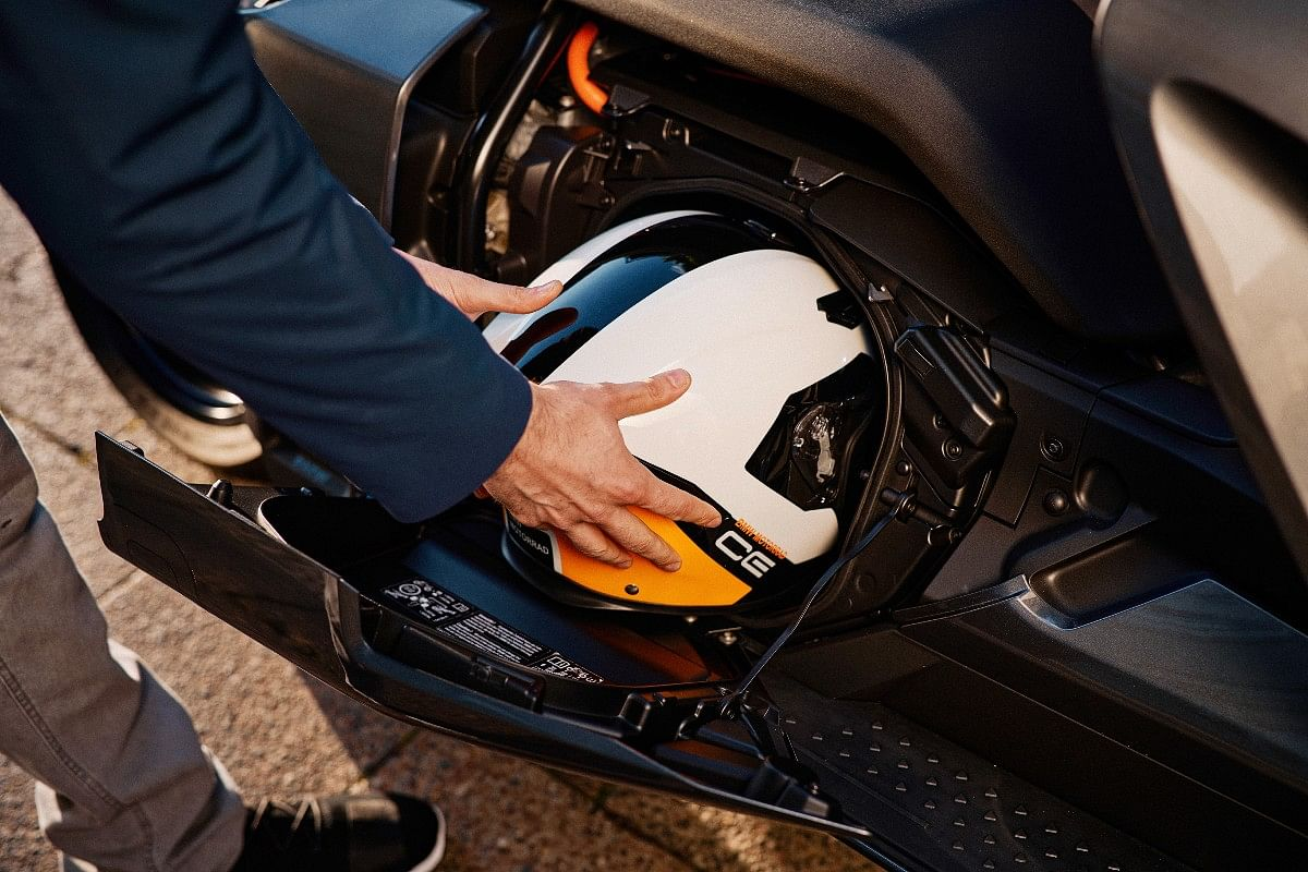 Underseat helmet storage gets side hinged opening for easy access even while you're sitting