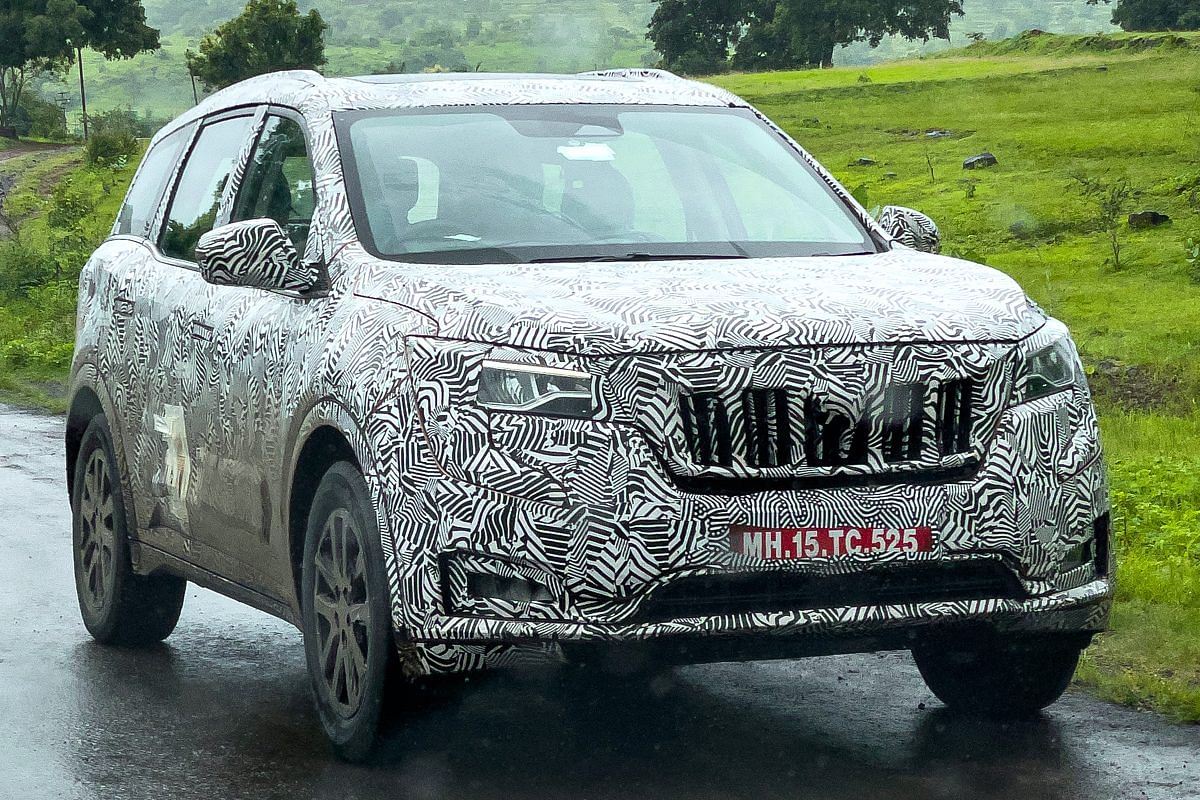 This XUV700 test car might have the new twin peak logo under the camouflage
