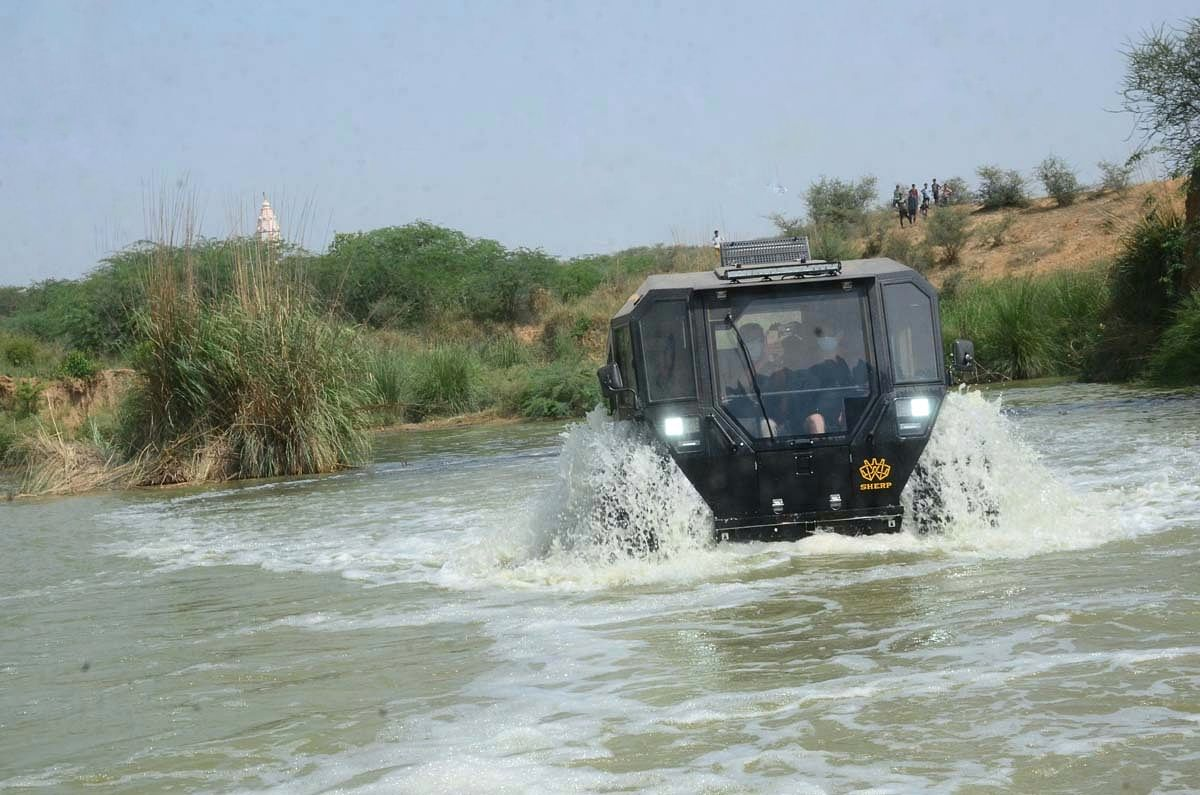 The Sherp's 71-inch tyres double up as flotation devices  and propellers as well