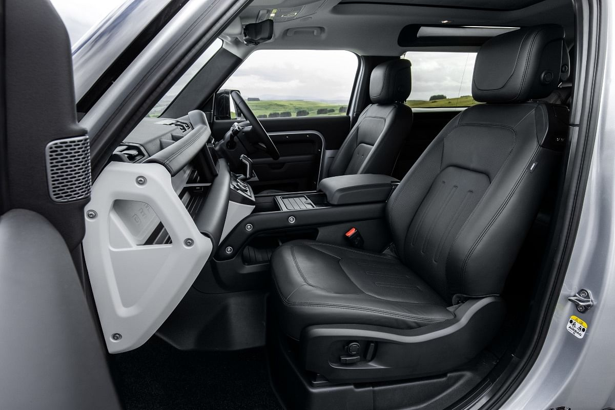 Front seats are electronically adjustable whle the centre armrest doubles up as the jump seat