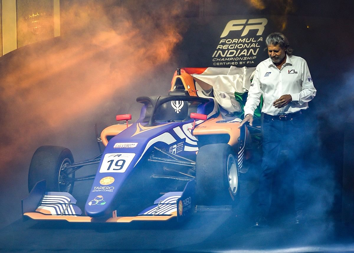 Former Indian cricketer Kapil Dev poses with the new Formula Regional Indian championship cars