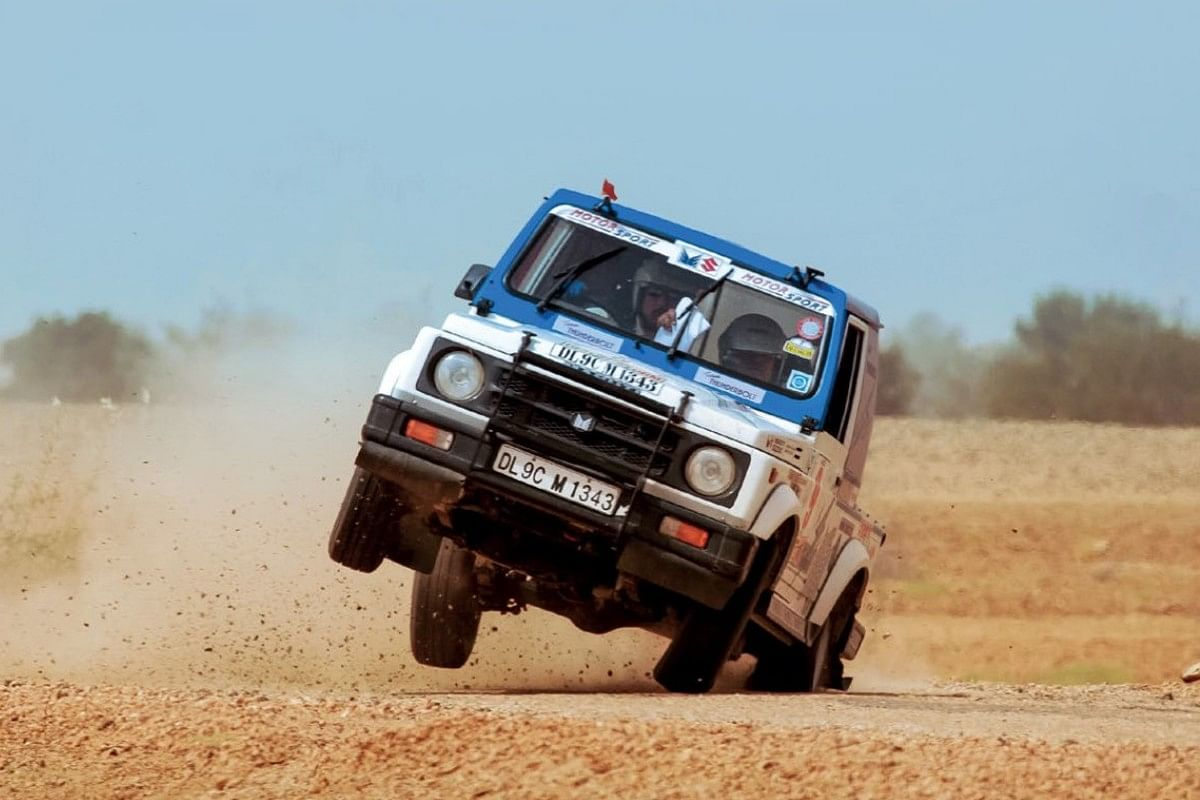 Rally drivers doing their thing. Here's a Gypsy going flat-out at the Desert Storm