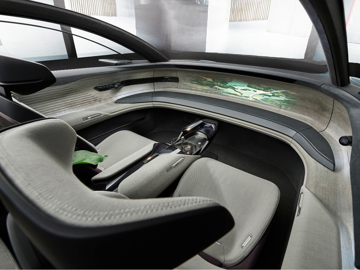 In autonomous mode, the steering wheel and pedals retract themselves for a 'first-class' experience