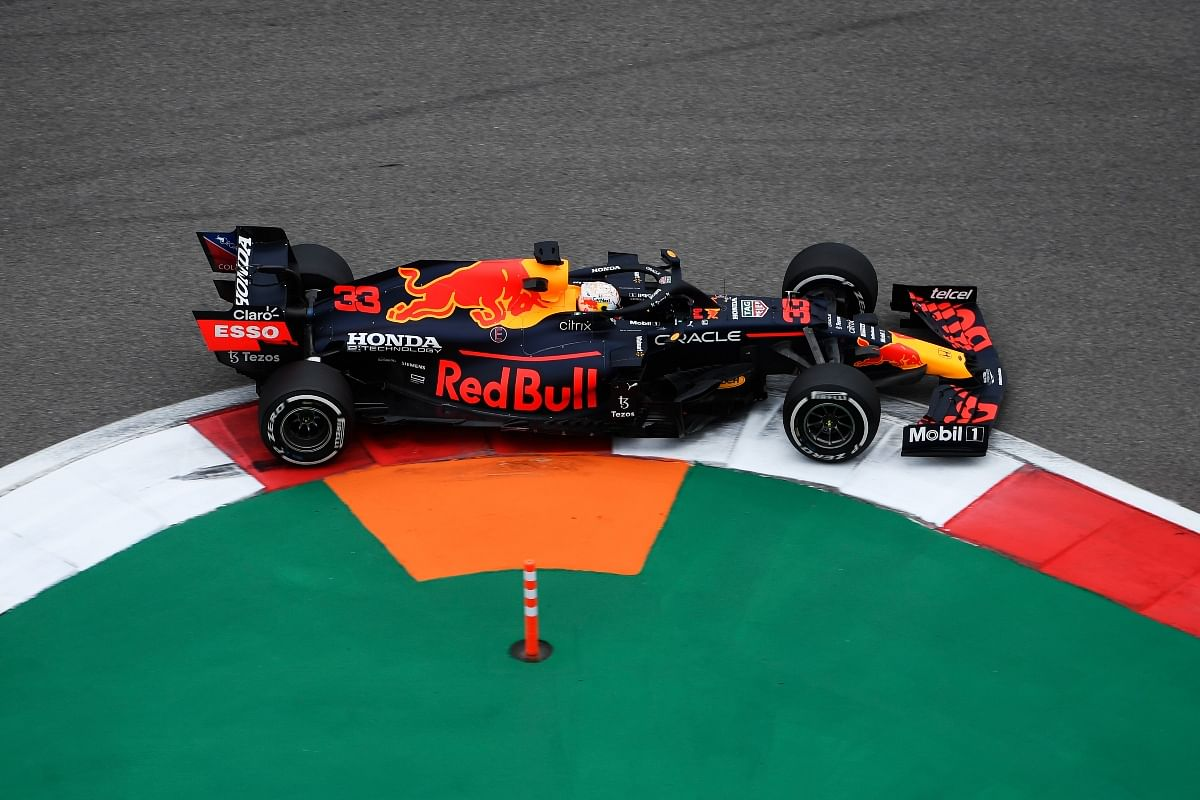 As the race started, Max put the pedal to the metal and started to make his way through the field carefully.