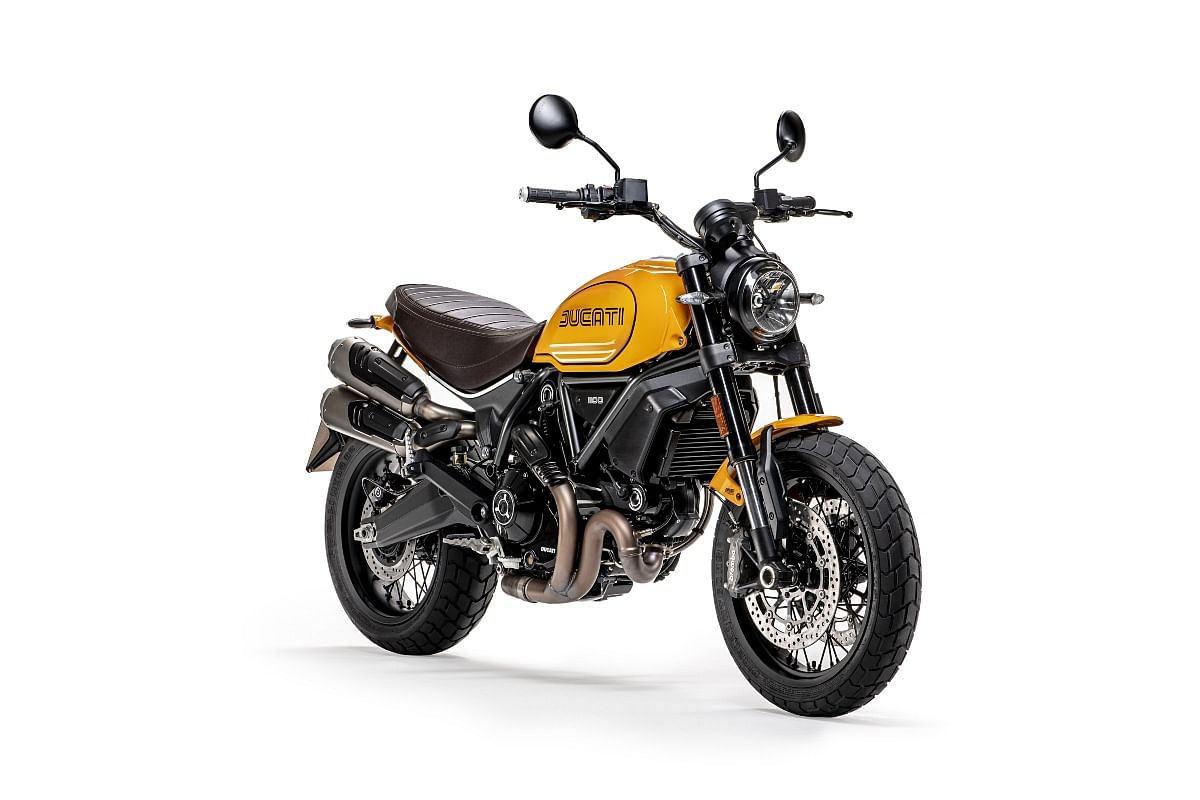 The 1100 TributePRO uses a yellow-ochre livery inspired by the 750 Sport