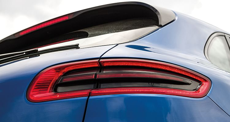Swooping roofline and LED tail lamps add to Macan's sporty flair
