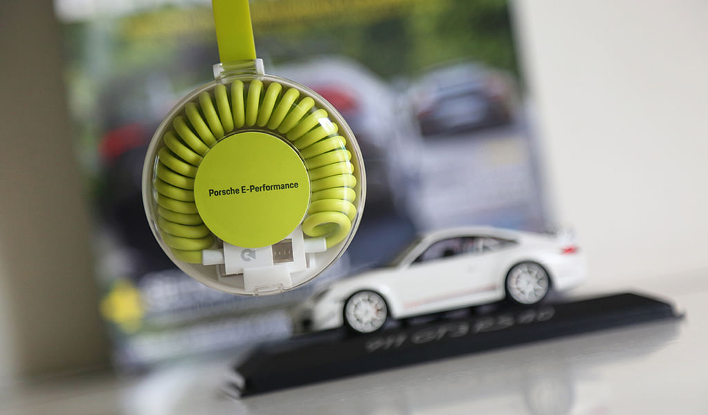 Win a Porsche E-Performance Universal Charging Cable by participating in the #EvoPorscheContest