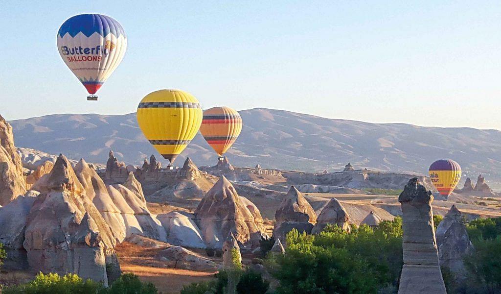 Hot air ballooning over the Fairy mountains in Cappadocia, Turkey