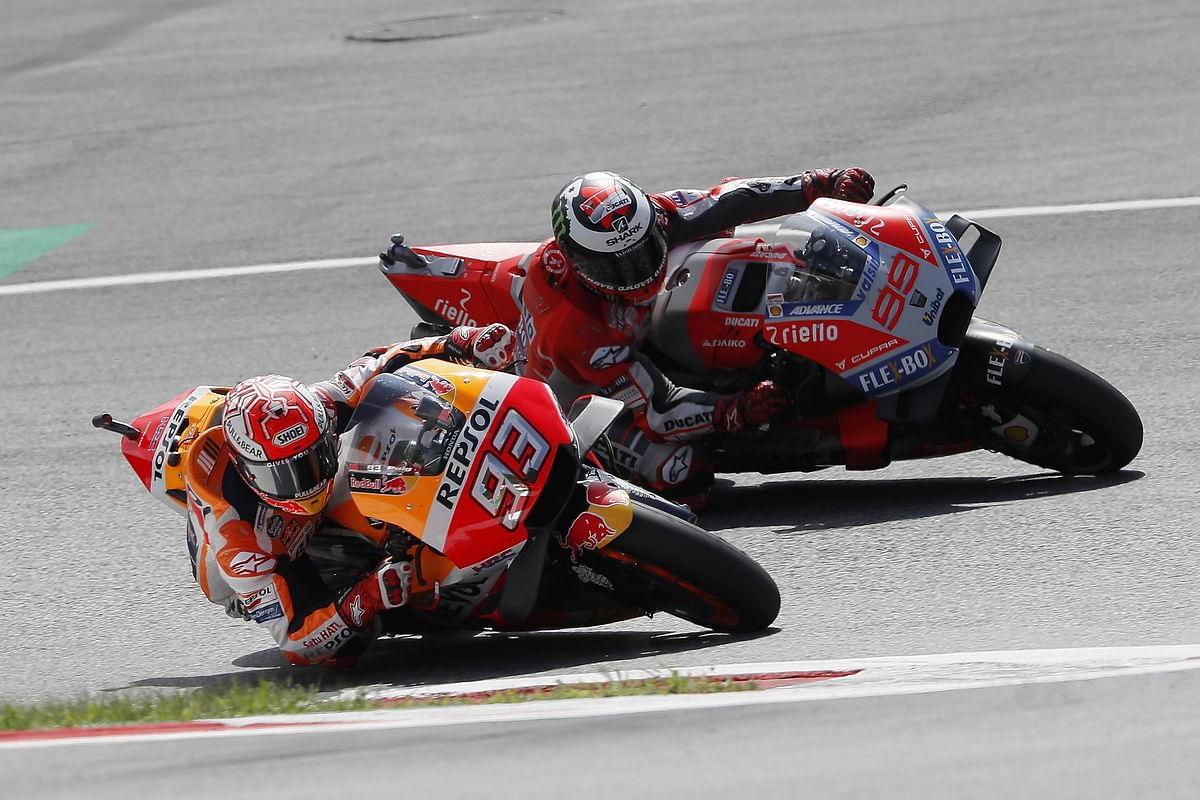 Lorenzo keeps Marquez at bay to win Austrian GP