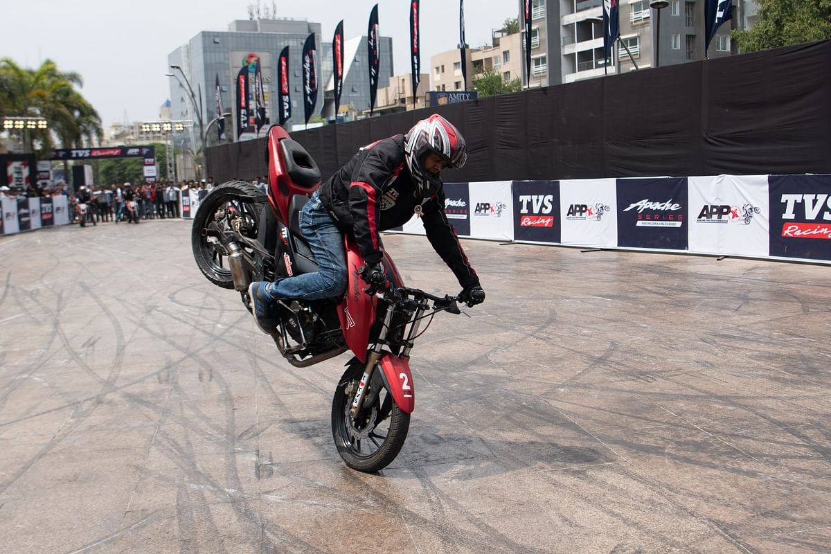 Endo or rolling stoppie by one of the performers