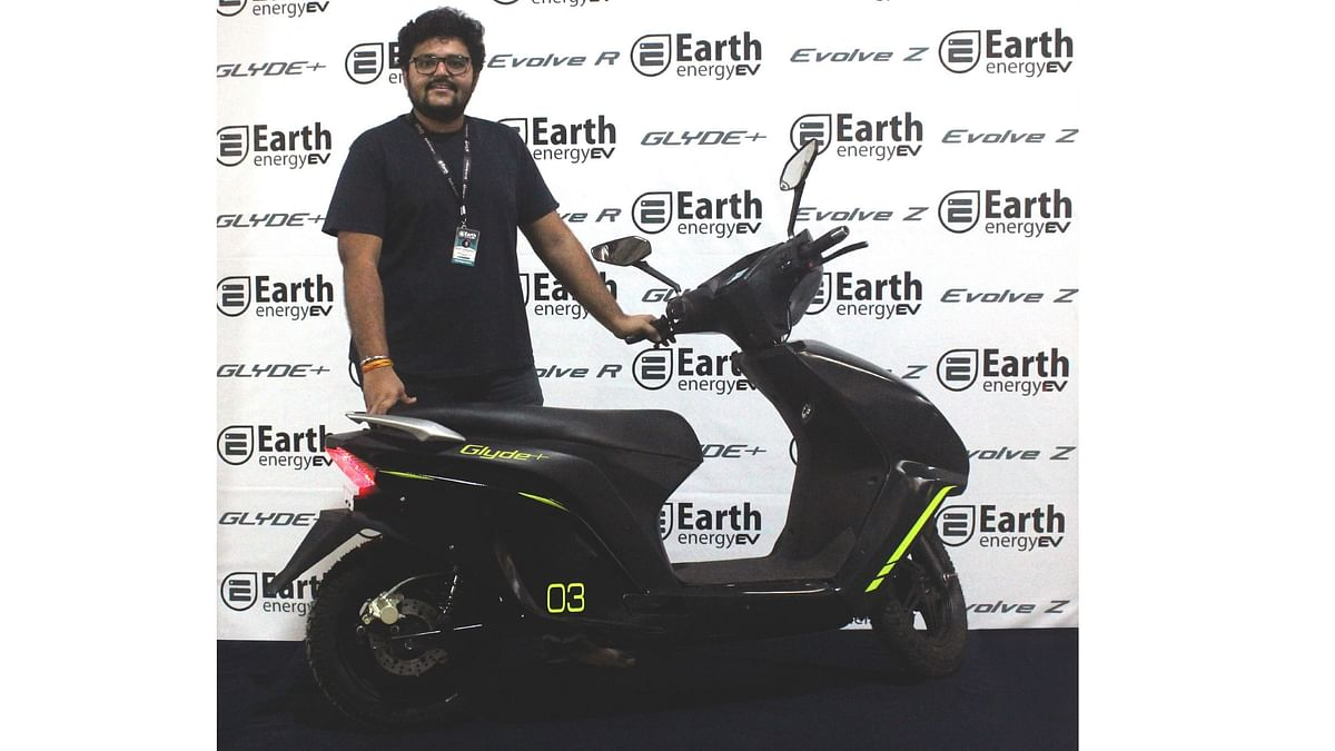 Rushi Shenghani, founder, Earth Enegy, with the Glyde+ e-scooter