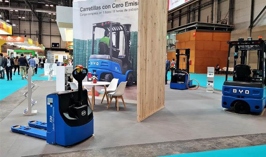 """<div class=""""paragraphs""""><p>BYD Forklift stand showcasing its electric forklift trucks, including the PTW20S pallet truck</p></div>"""