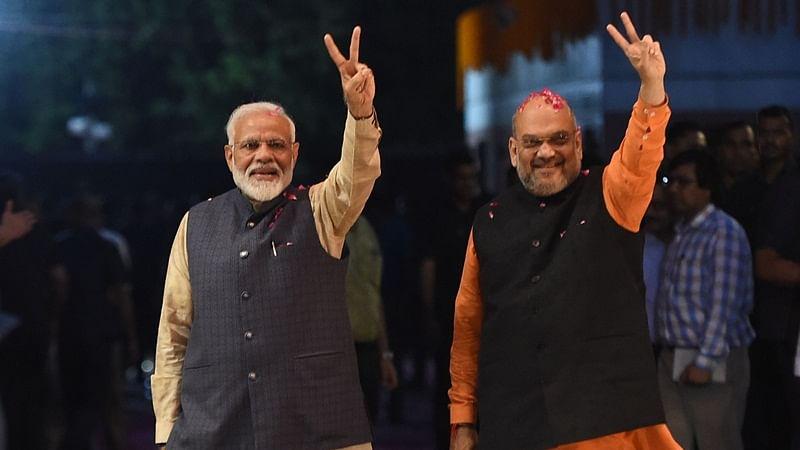 Prime Minister Narendra Modi (L) and (R) Union Home Minister Amit Shah