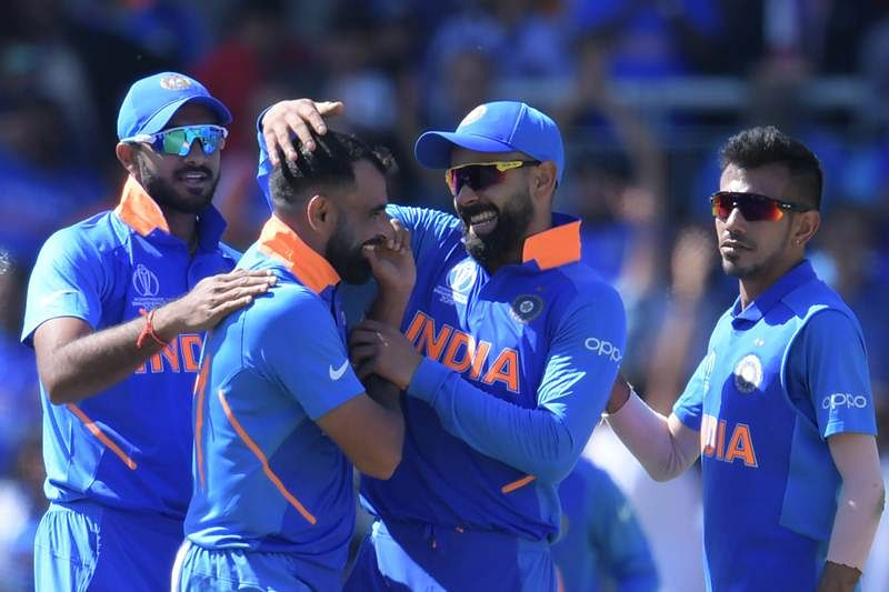 Team India celebrates a wicket against West Indies