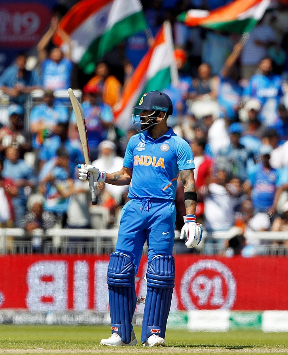 Indian batsman Virat Kohli celebrates his Half-Century during a match against West Indies in ICC CWC 2019 at Old Trafford in Manchester on Thursday.