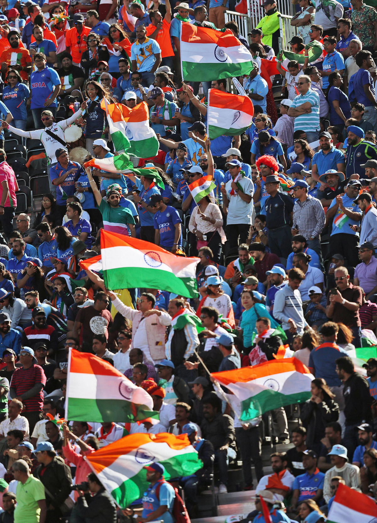 Indian cricket fans wave their national flags during the Cricket World Cup match between West Indies' and India