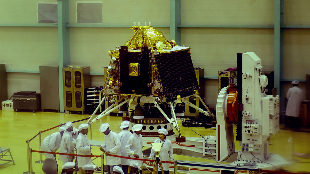 ISRO personnel work on the orbiter vehicle of Chandrayaan-2, India's first moon lander and rover mission planned and developed by ISRO at ISRO Satellite Integration and test establishment (ISITE), in Bengaluru