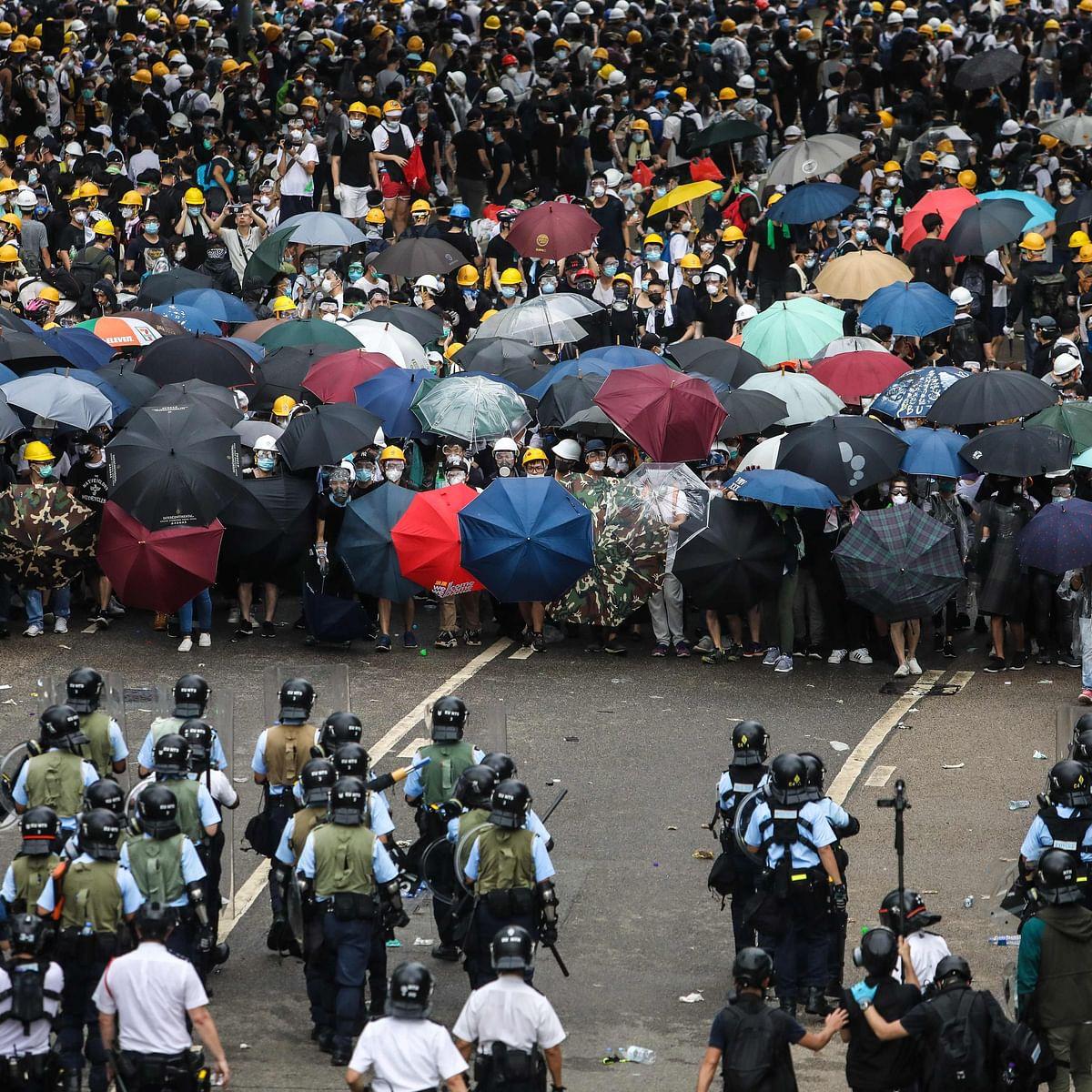 Hong Kong protesters end blockade of police HQ