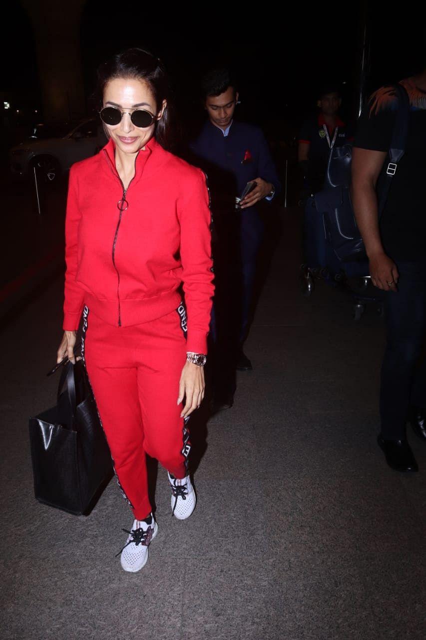 Malaika Arora's latest Red Fendi track pants cost Rs 44K!
