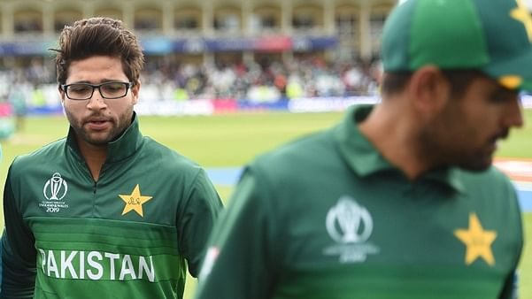 Pakistan's Imam-ul-Haq leaves the field at end of play during the 2019 Cricket World Cup group stage match between West Indies and Pakistan at Trent Bridge in Nottingham, central England, on May 31, 2019. - West Indies won by seven wickets with 218 balls remaining.