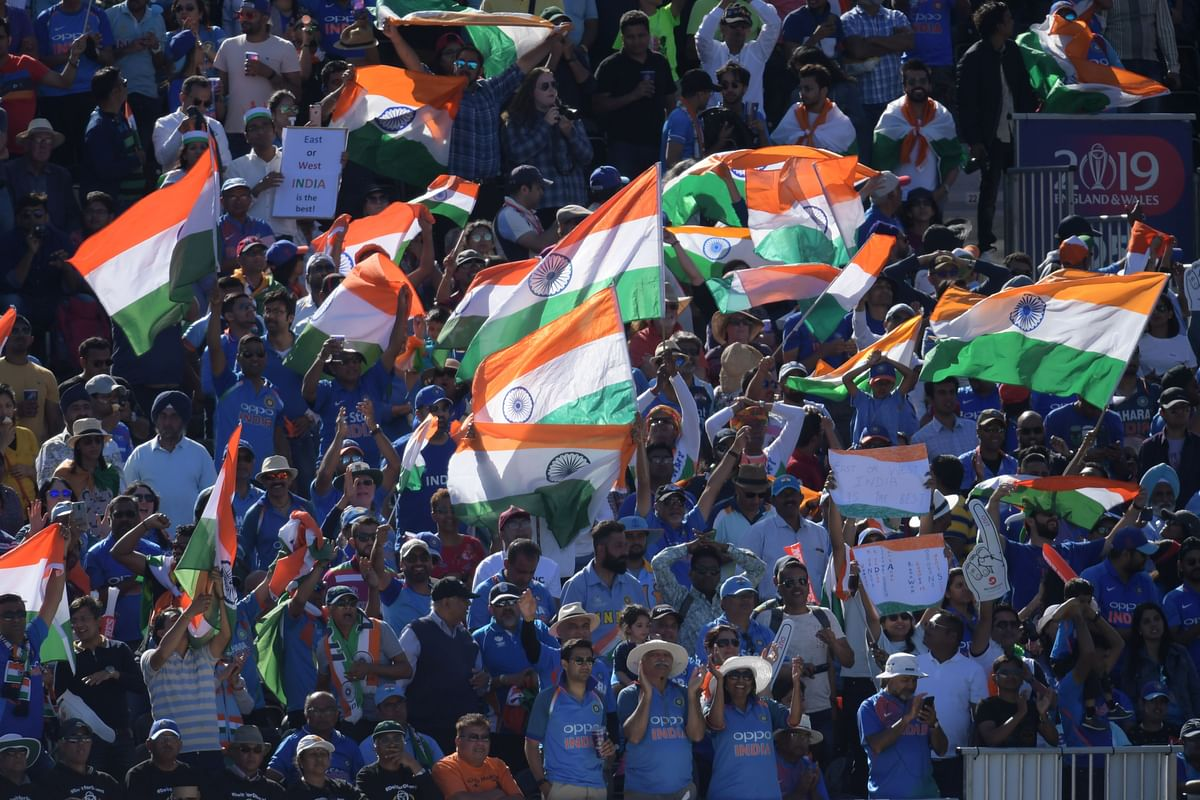 India's supporters cheer during the 2019 Cricket World Cup group stage match between West Indies and India.
