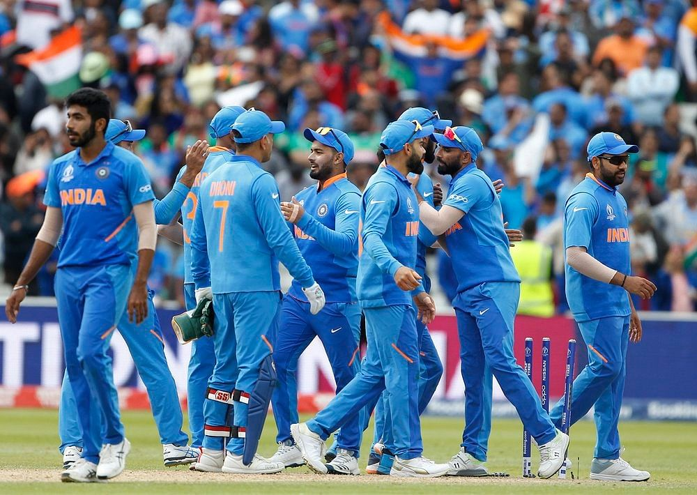 Indian squad celebrate after winning the match against Bangladesh in ICC CWC 2019 at Edgbaston in Birmingham on Tuesday