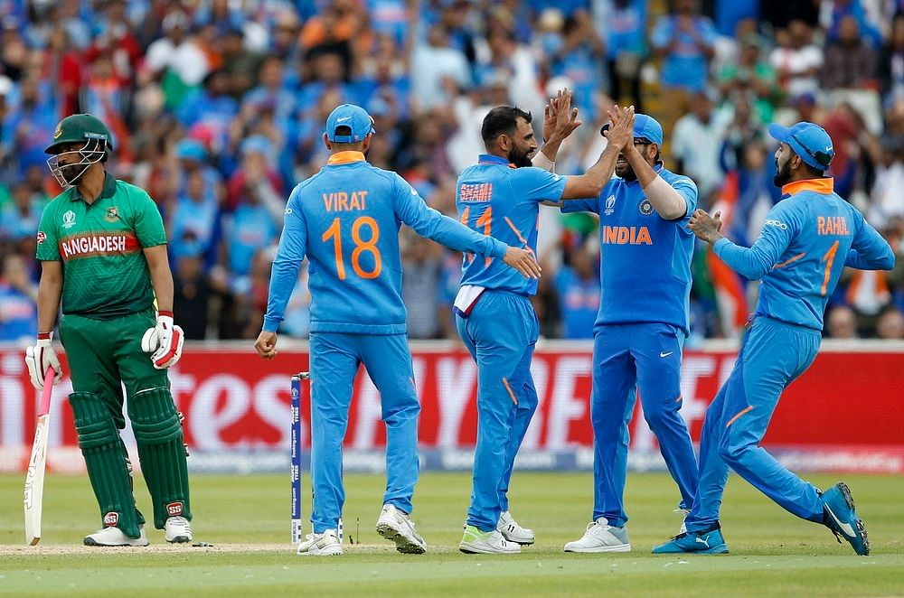 Indian bowler Mohammad Shami celebrates with teammates the dismissal of Tamim Iqbal during a match against Bangladesh in ICC CWC 2019 at Edgbaston in Birmingham on Tuesday