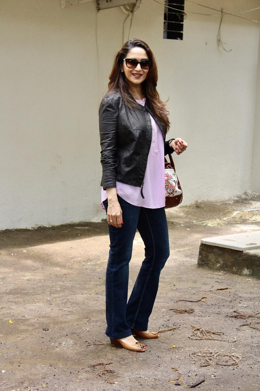 Evergreen beauty Madhuri Dixit clicked by shutterbugs in the city.
