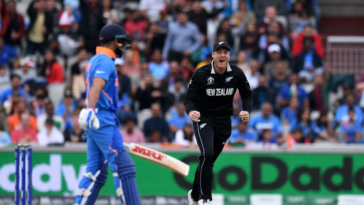 New Zealand's Martin Guptill celebrates  the wicket of India's captain Virat Kohli (L) for one during the 2019 Cricket World Cup first semi-final between New Zealand and India at Old Trafford in Manchester, northwest England, on July 10, 2019