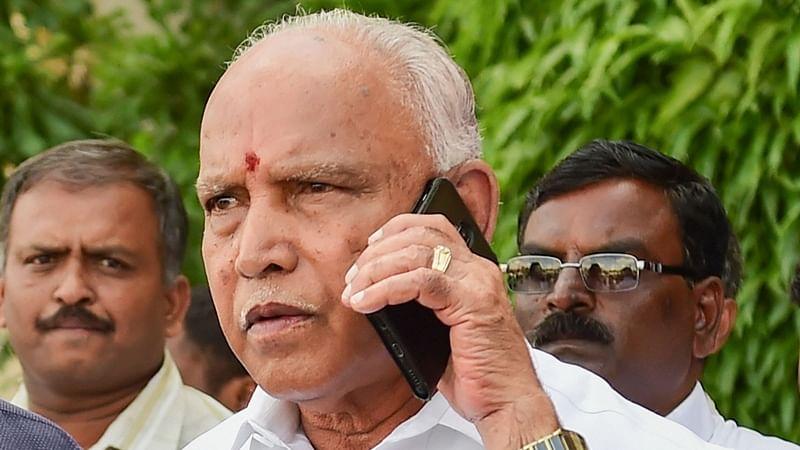 Karnataka Chief Minister BS Yediyurappa (C)