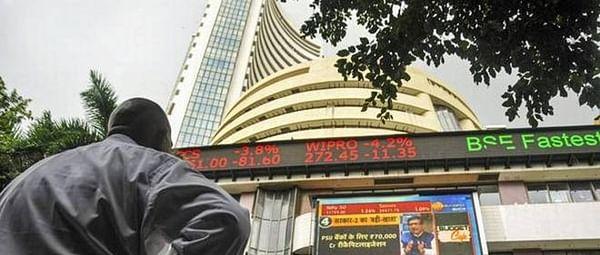 Sensex drops over 200 pts; RIL soars 8 pc