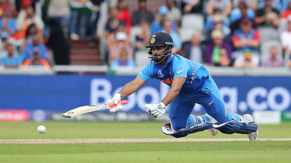 India's Rishabh Pant dives to avoid a run out during the Cricket World Cup semifinal match between India and New Zealand at Old Trafford in Manchester, Wednesday, July 10, 2019.