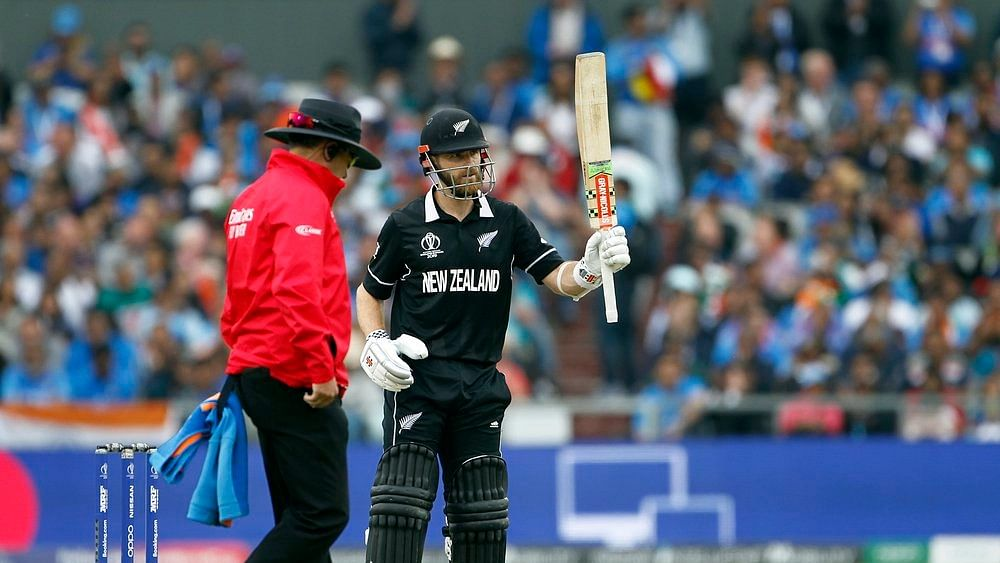New Zealand's batsman Kane Williamson celebrates his half century during the Semi Final match against India at Old Trafford in Manchester on Tuesday.