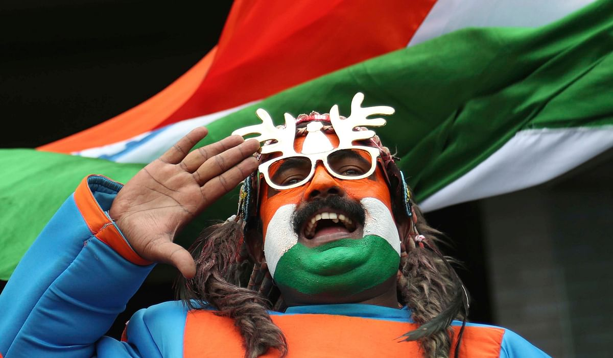An Indian fan salutes while the national anthem of his country is played before the start of the Cricket World Cup match between Bangladesh and India at Edgbaston in Birmingham, England, Tuesday, July 2, 2019