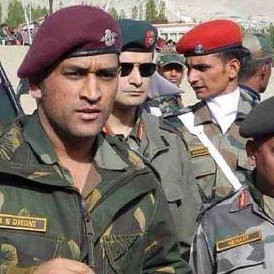 Why does Dhoni want to train with the Parachute Regiment of the Indian Army? Who are they?