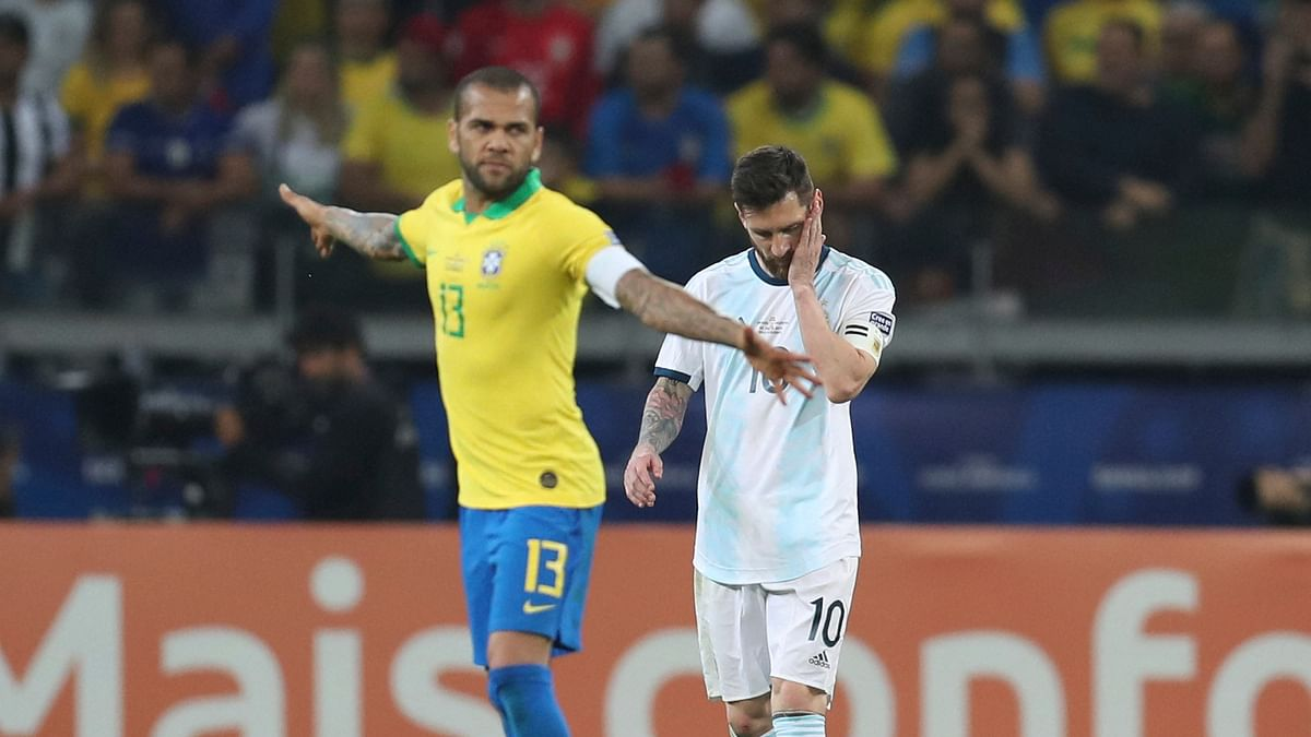 Argentina's Lionel Messi, right, looks down after losing to Brazil during a Copa America semifinal soccer match at the Mineirao stadium in Belo Horizonte, Brazil, Tuesday, July 2, 2019