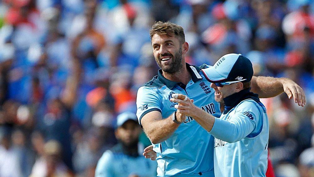 England's Liam Plunkett (L) celebrates the team mate