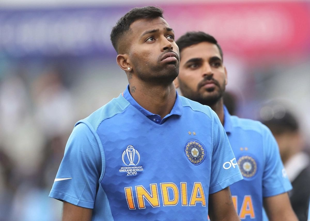 Hardik Pandya, left, reacts after their loss in the World Cup semi-final match against New Zealand.