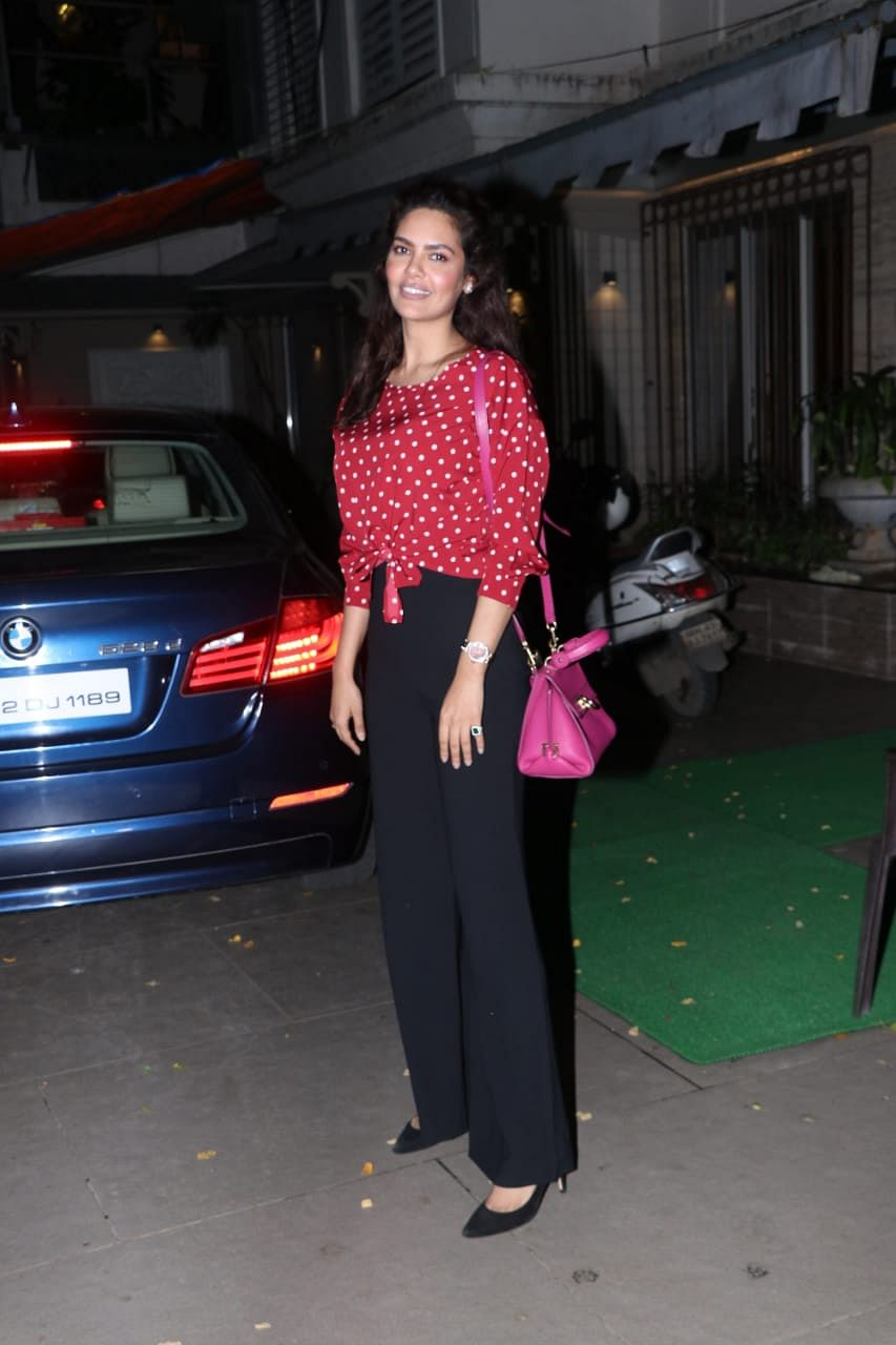 Esha Gupta was clicked by paps in the city, she was all smiles to camera in red and white polka dot crop top with pink handbag.