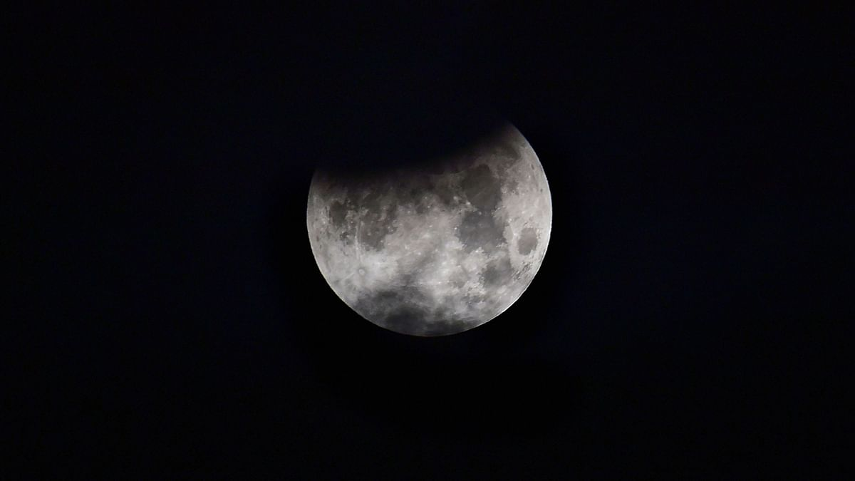 A view of the moon during a partial lunar eclipse, as seen from New Delhi, early Wednesday, July 17, 2019