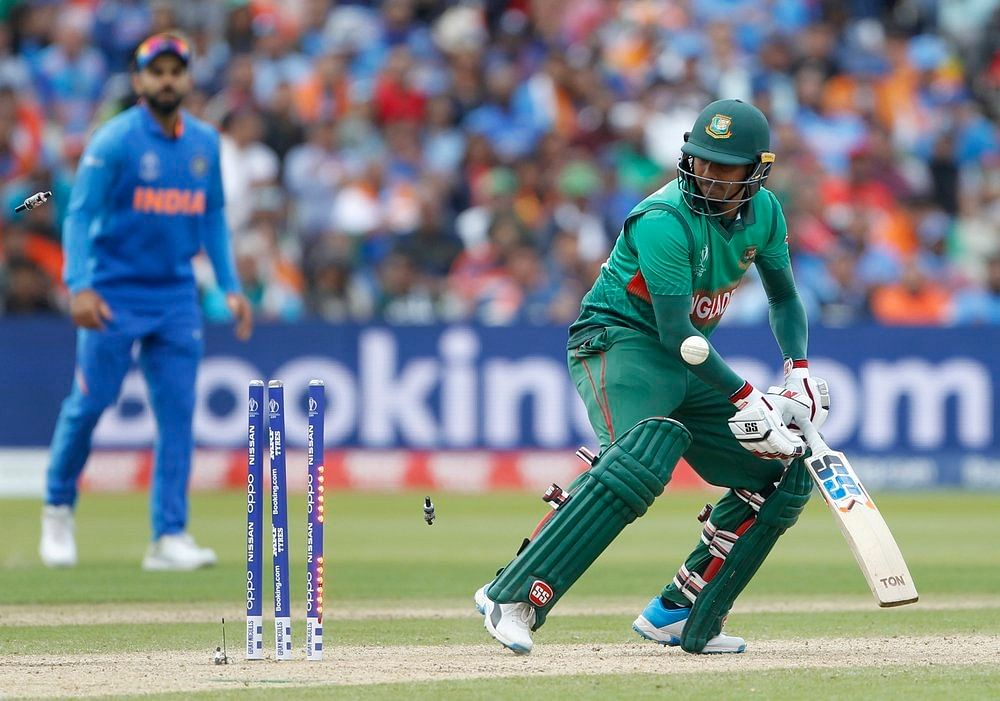 Bangladesh's Mosaddek Hossain gets bowled during a match against India in ICC CWC 2019 at Edgbaston in Birmingham on Tuesday