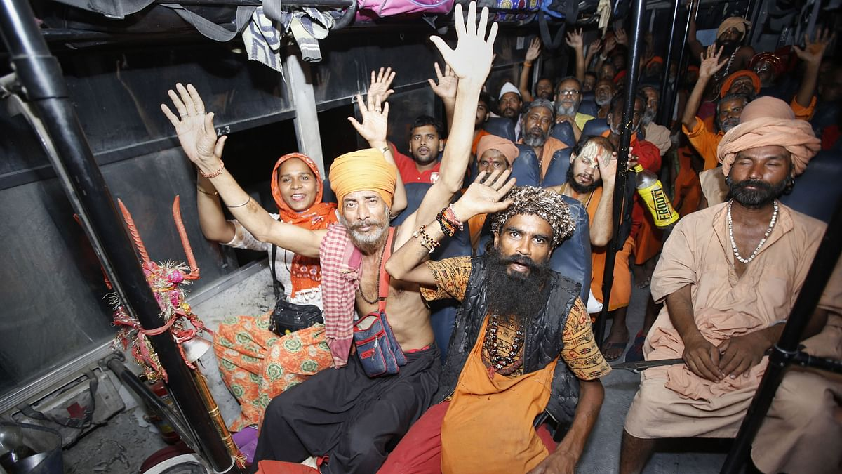 Devotees chant religious slogans as they leave for Amarnath Yatra from Jammu base camp