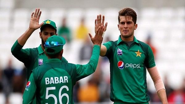 Pakistan's pacer Shaheen Shah Afridi celebrate with babar Azam after taking wicket