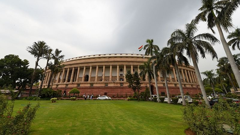 Parliament passes Aadhaar bill, government to bring law on data protection