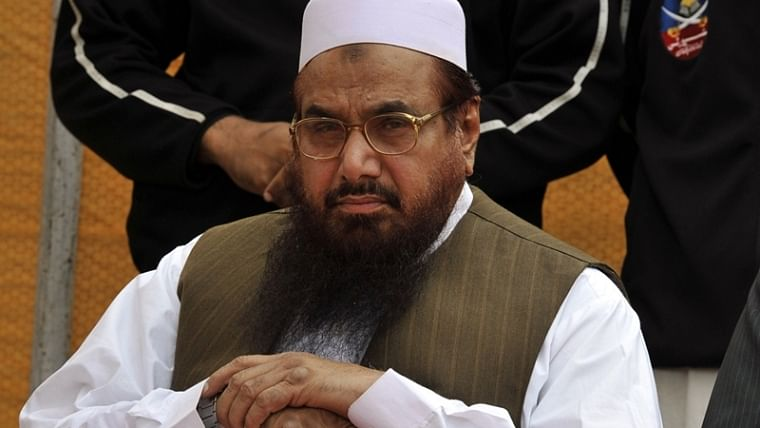 Amid growing global pressure, Pakistan books Hafiz Saeed for terror financing in 23 cases